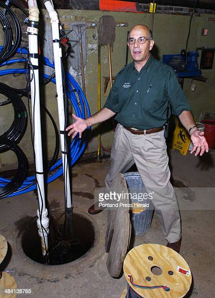 Staff Photo by John Patriquin Wed 8/23/06 Rich Pfirman owner of Tilson True Value Hardware in Dexter shows the sump pump in the basement of the store...