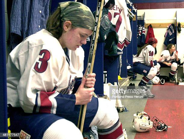 Staff Photo by John Patriquin Wed Jan 09 2002 USM womens hockey player Avery McGill sits alone in deep thought in the locker room prior to a game...
