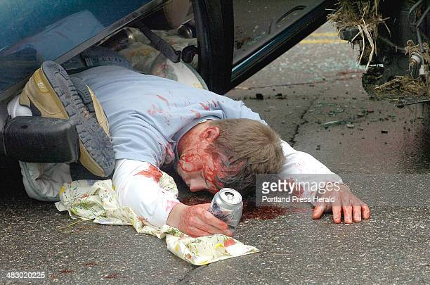 Staff Photo by John Patriquin Wednesday May 10 2006 Portland HS Sr Dylan Baker plays dead holding a empty beer can after a mock fatal two car...