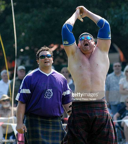 Dan Dillon of Long Island New York watches his Caber Toss during the Maine Highland Games in Brunswick Saturday August 16 2008