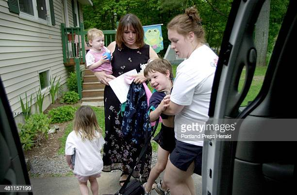 Staff Photo by Shawn Patrick Ouellette Friday June 13 2003 Kim Cote of Little Rascals Day Care in Gorham helps Zachary 4 into the car as Zachary's...