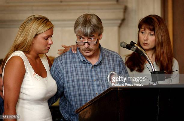 Staff Photo by Shawn Patrick Ouellette Monday June 30 2003 Dennis St Laurent father of Amy St Laurent looks directly towards Jeffery Gorman as he...