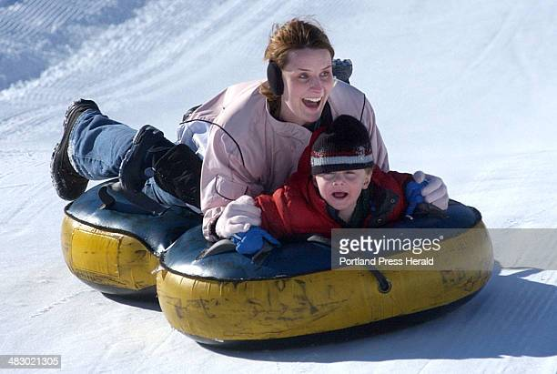 Staff photo by Shawn Patrick Ouellette Sunday February 13 2005 Crystal Parks makes her way down the hill at Seacost Snow Park with her son Noah Parks...