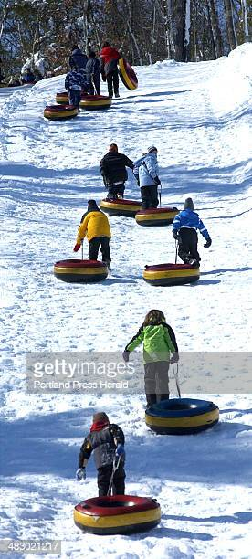 Staff photo by Shawn Patrick Ouellette Sunday February 13 2005 Tubers make their way up the hill at Seacoast Snow Park in North Windham Sunday