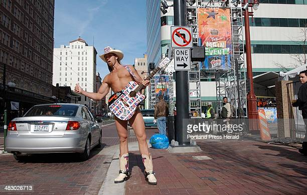 Staff Photo by Shawn Patrick Ouellette Wednesday January 28 2004 'The Naked Cowboy' Robert Burck of New York City makes his way down Main st in...