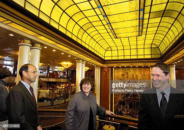 Staff photo / JIM EVANS -- Governor John Baldacci takes a tour guided Monday by Queen Mary 2 sports director Jason Bibby, stopping in the Brittannia...