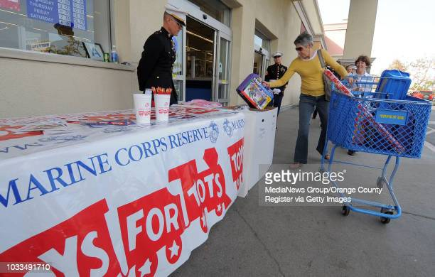 SCOTT VARLEY Black Friday shoppers turned out ready to shop and give Friday at the Torrance Toys R Us store where Marine reservists were on hand for...