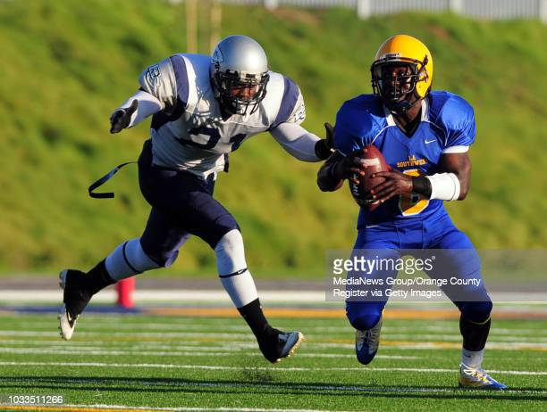 SCOTT VARLEY El Camino and LA Southwest colleges face each other in their season opener football game El Camino won 4612 QB Marcell Dejean is chased...