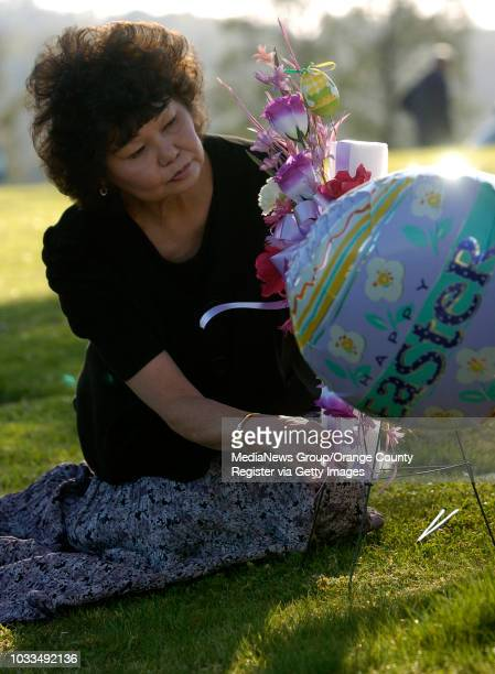 SCOTT VARLEY Linda Pierce brings flowers and decorations to her father Thomas Leigh's grave at Green Hills Memorial Park The cemetery is celebrating...