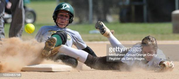SCOTT VARLEY Mira Costa at West girls softball Mira Costa's Amanda Gard beats the throw to West shortstop Dechi Garcia in the 1st inning and ending a...