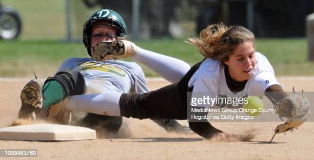 SCOTT VARLEY Mira Costa at West girls softball West shortstop Dechi Garcia dives for a ball thrown to her by the catcher in the 1st inning as Amanda...