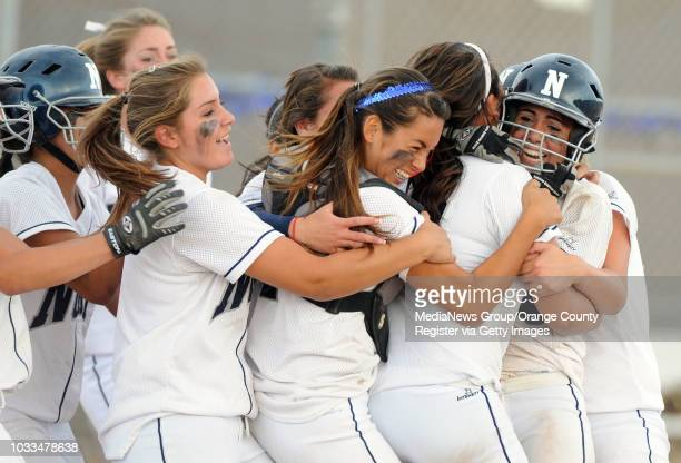 Staff Photo: SCOTT VARLEY - North defeated Northview in 11 innings 2-1 to advance to the CIF-SS Div. V semi-final softball game. North players mob...