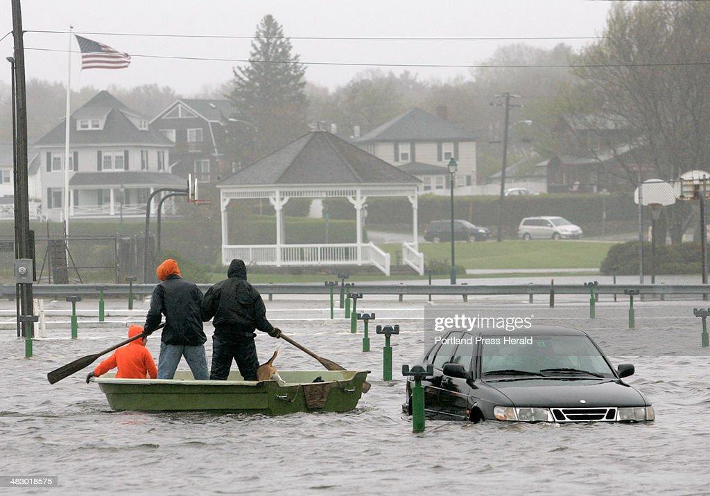 Cameron Kimball, 15, Mike Chapman, 15, and David Young, 25, float through a parking lot at York Beac... : News Photo