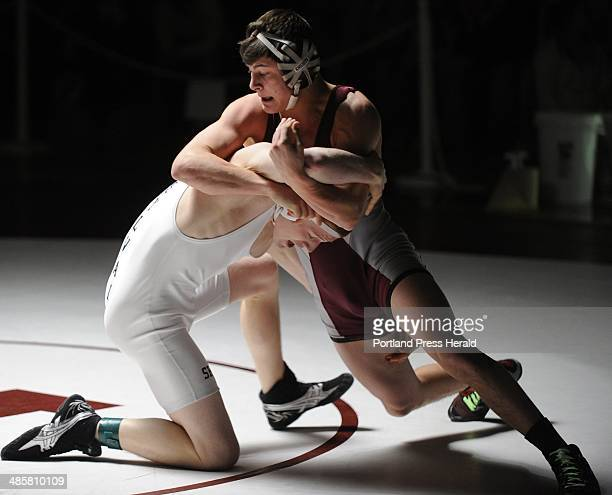 Staff Photographer. Saturday, February 13, 2010. Noble's Joseph Badger foils a take-down attempt by Massabesic's Justin Dumond in the 140 lb class of...