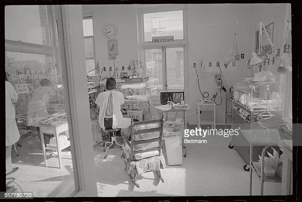 Staff physicians and the head nurse work with infants in the Intensive Care Nursery at Mt Zion Hospital here after striking nurses of the California...