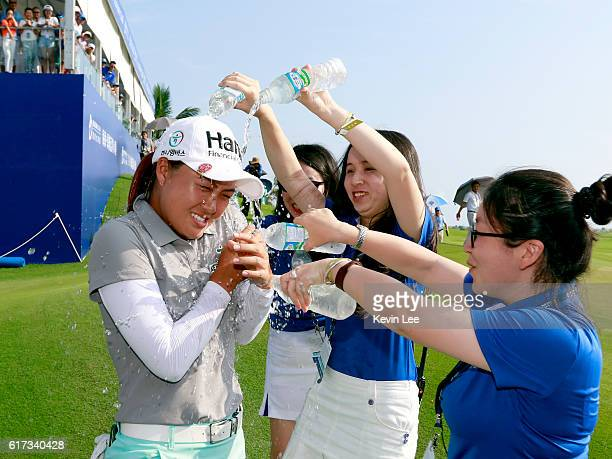 Staff pour water on Minjee Lee of Australia on the 18th green after she win the Blue Bay LPGA on Day 4 on October 23 2016 in Hainan Island China