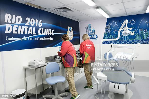 Staff prepare a dental clinic at the Olympic and Paralympic Village for the 2016 Rio Olympic Games in Rio de Janeiro, Brazil, on July 23, 2016. / AFP...