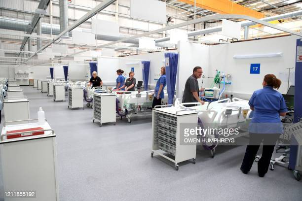 Staff prepare bays at the NHS Nightingale Hospital North East in Sunderland northeast England on May 5 2020 providing 460 beds for patients with...