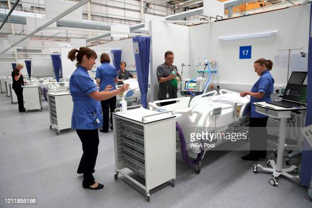 Staff prepare bays at the NHS Nightingale North East hospital on May 05 2020 in Sunderland United Kingdom The country continued quarantine measures...