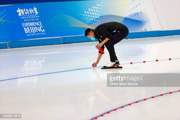 Staff prepare before a match on day one of the Speed Skating China Open, a test event of the 2022 Beijing Winter Olympic Games, at the National Speed...