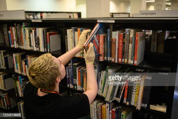 Staff prepare books and resources in Manchester City Library the day before reopening to the general public with new measures in place to mitigate...