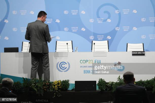 Staff prepare for an afternoon plenary session on the second day at the COP 23 United Nations Climate Change Conference on November 7 2017 in Bonn...