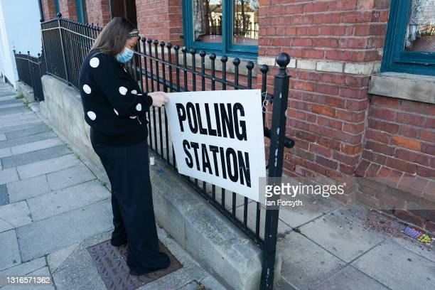 Staff prepare signs outside polling stations as they prepare to open in Hartlepool on May 06, 2021 in Hartlepool, England. Today voters in Hartlepool...