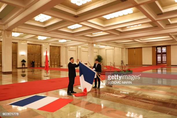 TOPSHOT Staff prepare the French flag ahead of a visit by French President Emmanuel Macron for his meeting with Chinese Prime Minister Li Keqiang in...