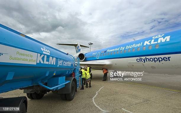 Staff prepare the KLM Fokker 70 cityhopper airplane and fill it with biofuel in Schiphol on August 31 2011 Dutch airline KLM announced that it will...