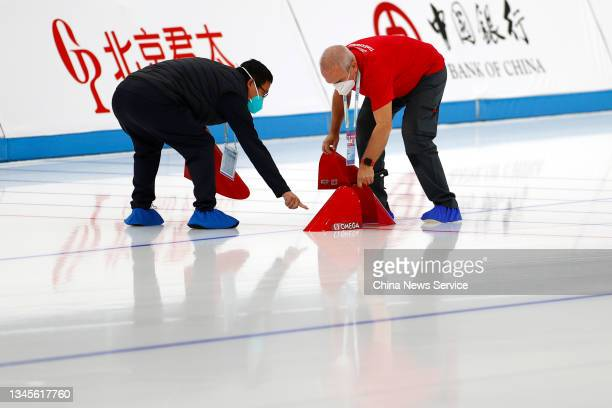 Staff prepare timing device before a match on day one of the Speed Skating China Open, a test event of the 2022 Beijing Winter Olympic Games, at the...