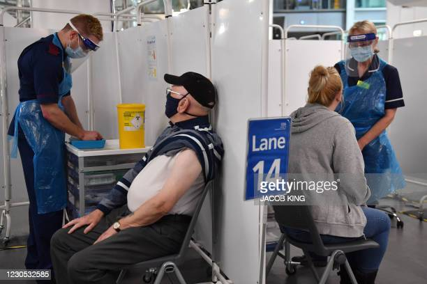 Staff prepare to administer Covid-19 vaccines at the NHS vaccine centre that has been set up at the Millennium Point centre in Birmingham, central...