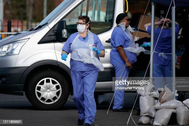 NHS staff prepare to swab a member of the public at a drive through Coronavirus testing site on March 12 2020 in Wolverhampton England The National...