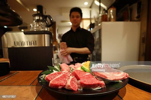 A staff prepares a dish of Wagyu beef steaks in a restaurant operated by Meat Companion Co in Tokyo Japan on Monday March 24 2014 Wagyu farmers are...