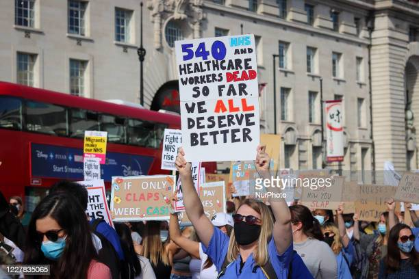 Staff protest outside Downing Street after marching from St Thomas's Hospital at the 'March For Pay Justice for NHS and Key Workers' on 29 July, 2020...