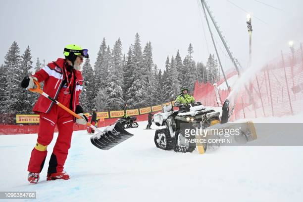Staff remove snow ahead of the Men's Downhill event of the 2019 FIS Alpine Ski World Championships at the National Arena in Are Sweden on February 9...