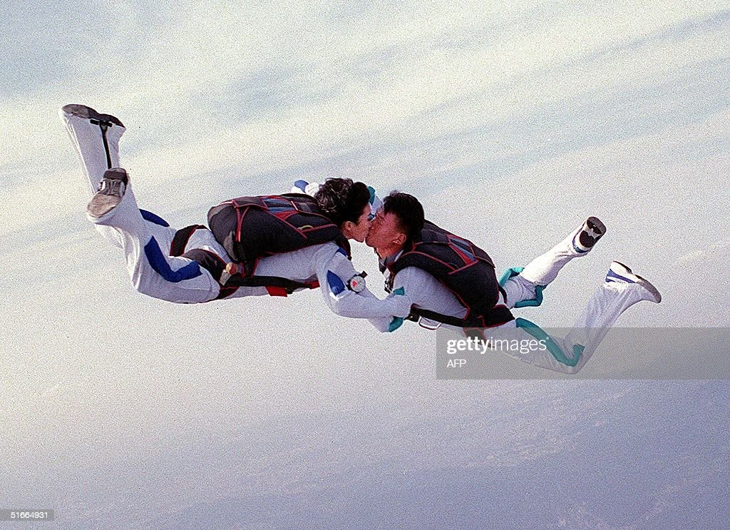Staff Seargeant Park Chul-Soon (L) kisses her husband, Seargent Kim Im-Soo, as the two Special Forces troopers freefall after their marriage ceremony in the sky over South Korea 15 October 1999.
