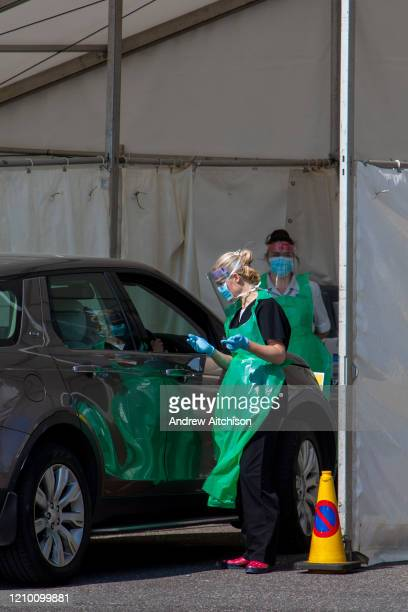Staff see a patient who remains in their car at a drive-through Primary Care Clinical Assessment Centre where potentially infectious and symptomatic...