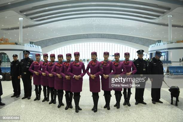 Staff selected for the first train which is to start operation on ChongqingGuiyang railway make their debut at Chongqing West Railway Station on...