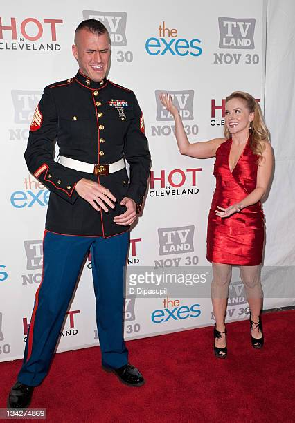 Staff Sergeant Eric Worth and Kelly Stables attend the TV Land holiday premiere party for Hot in Cleveland The Exes at SD26 on November 29 2011 in...