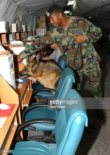 Staff Sergeant Hewitt Cox with the 39th Security Forces Squadron runs Tara an explosives detection working dog through her paces at the morale tent...
