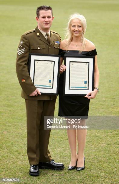 Staff Sergeant Kim Hughes and Christina Schmid the widow of Staff Sergeant Olaf Schmid hold their George Cross Citations which were awarded at a...