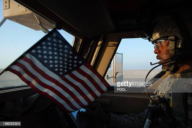 US Staff Sergeant Prince House from the 3rd Brigade Combat Team 1st Cavalry Division rides in a Mine Resistant Ambush Protected vehicle as the last...