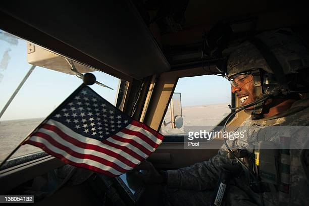 Staff Sergeant Prince House with the 3rd Brigade Combat Team 1st Cavalry Division smiles as his Mine Resistant Ambush Protected vehicle nears the...