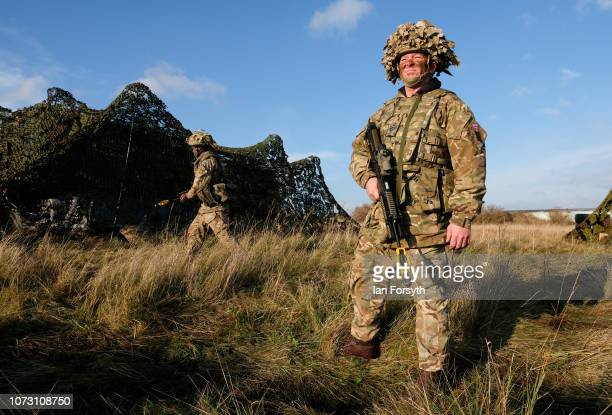 Staff Sergeant Richard Kyle stands among camouflaged vehicles as troops from 4 Regiment Royal Logistic Corps deploy to the Port of Hartlepool as they...