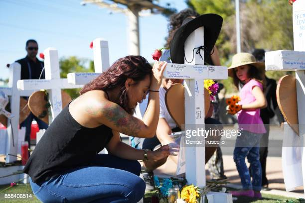 Staff Sergeant US Army Kimberly Carlin of Las Vegas Nevada mourns for her childhood friend Brennan Stewart October 6 2017 in Las Vegas Nevada On...