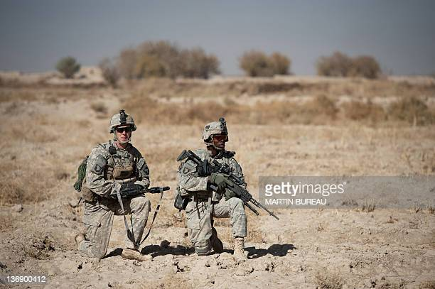 Staff Sergent Brian Michaud from Maine and Private First Class Richard Thompkins from Atlanta of the 502nd Infantry regiment 2nd Batallion Charger...