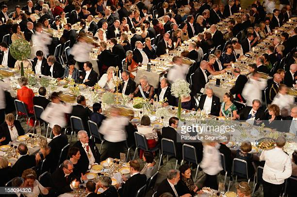 Staff serve guests at the main table during the Nobel Banquet after the 2012 Nobel Prize Ceremony at Town Hall on December 10 2012 in Stockholm Sweden