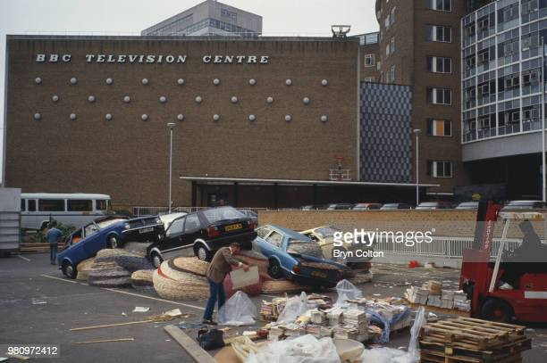 Staff setting up David Mach's installation titled 'MultiStorey Car Park' on display at the BBC Television Centre in Wood Lane London UK 27th May 1988