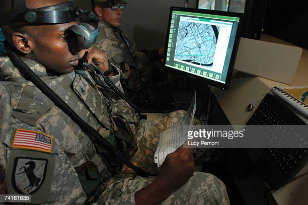 Staff Sgt Elvin Hamm of Elberton Georgia wears virtual reality goggles showing a simulated command of a convoy on the streets of Baghdad at the...