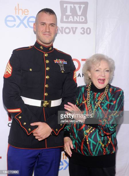 """Staff Sgt Eric Worth and actress Betty White attend the TV Land holiday premiere party for """"Hot in Cleveland"""" & """"The Exes"""" at SD26 on November 29,..."""